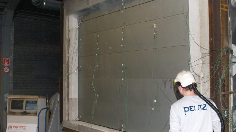 Fire resistant sectional door during the fire test; Tested and certified fire-resistance