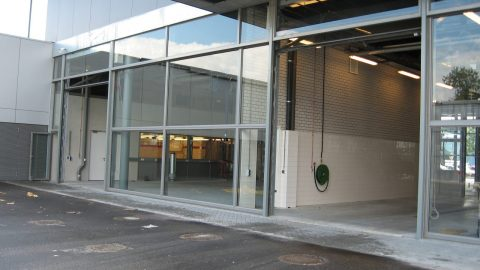 Special glass overheaddoors - High openingsspeeds - fast action - up & over doors - facade elements
